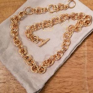 Kendra Scott rose goldtone necklace.